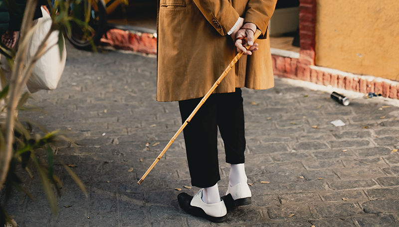 holding-wooden-walking-cane